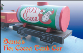 Papercraft imprimible y armable de un vagón con chocolate caliente de Santa Claus. Manualidades a Raudales.